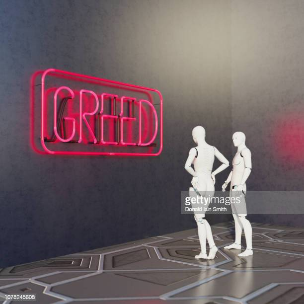 male and female android robots look at neon greed sign - greedy smith stock pictures, royalty-free photos & images