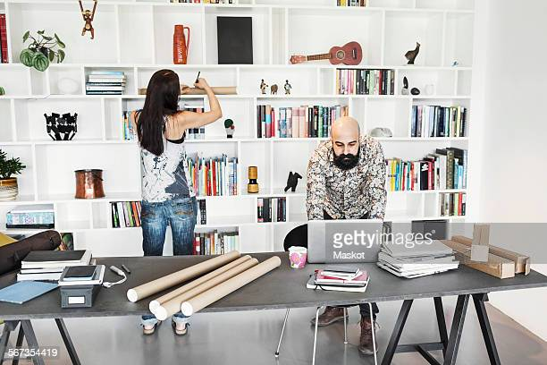 Male and female architects working at home office