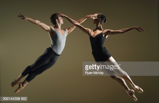 Male And Female Ballet Dancers Leaping Towards Each Other -6632