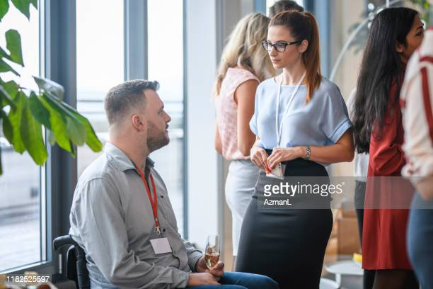 male and female business associates enjoying office party - publicity event stock pictures, royalty-free photos & images