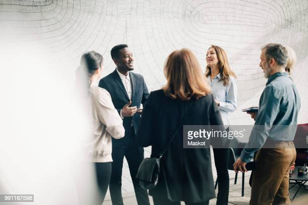male and female business colleagues discussing in meeting at office - event stock pictures, royalty-free photos & images