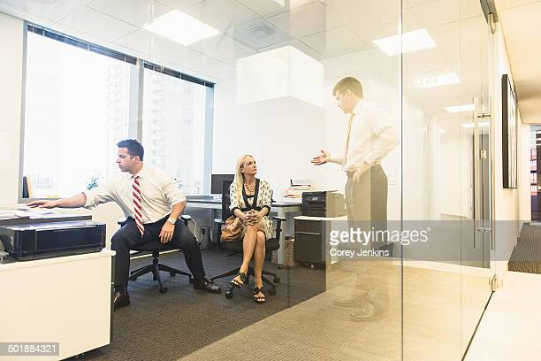 Male and female business lawyers meeting in office