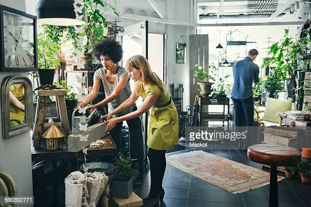 Male and female colleagues working in interior design shop