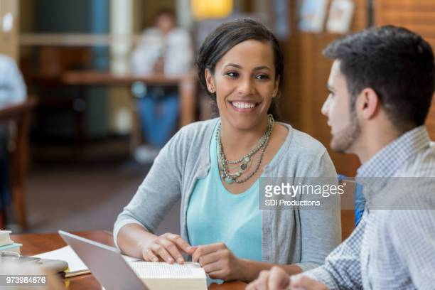 Male and female college students studying together
