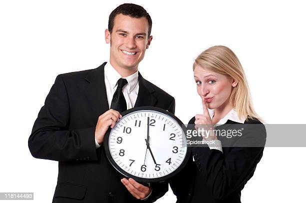 Male And Female Corporate Types With Clock