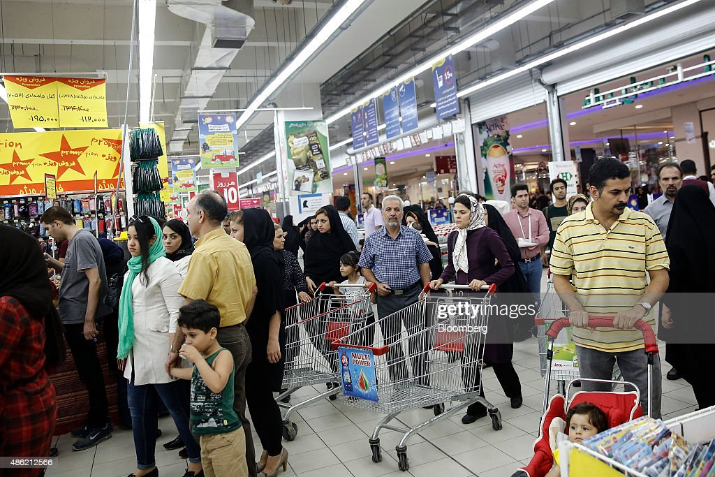 Male and female customers browse the shopping aisles at the