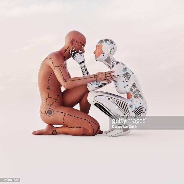 male and female cyborgs share an intimate moment - digital desire fotos stock-fotos und bilder