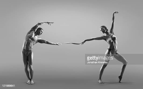 Male and female dancer connected through