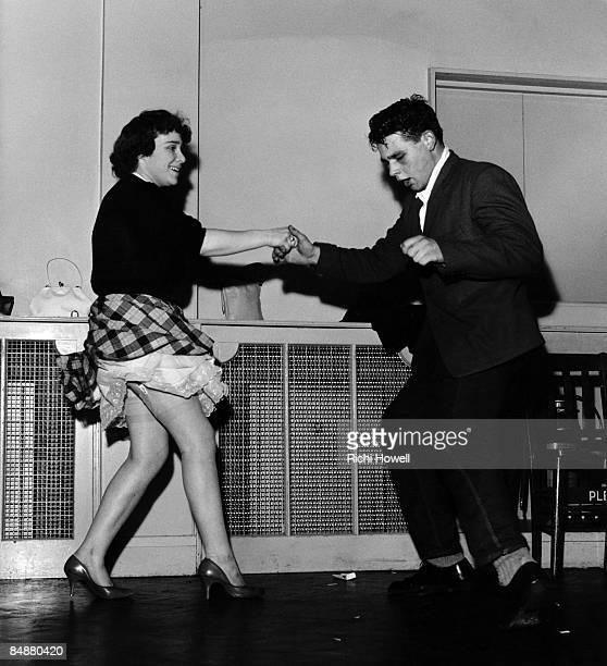 A male and female dancer jiving to rock'n'roll music in London in the late 1950s
