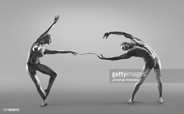 Male and female dancers connected through liquid