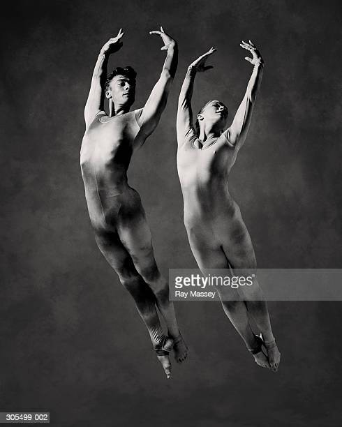male and female dancers in mid-air leap (b&w) - duet stock pictures, royalty-free photos & images
