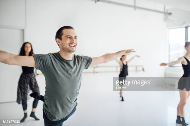 Male and female dancers practicing ballet dance