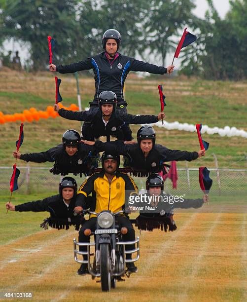 Male and female dare devils of the Indian police force perform on a bike at Bakshi Stadium where the authorities hold the main function during...