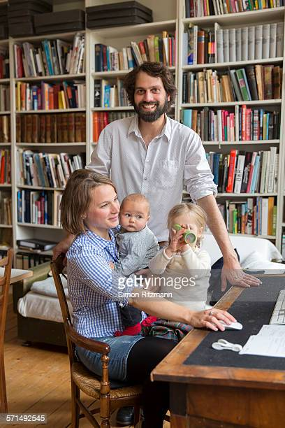 Male and female designer with two children.
