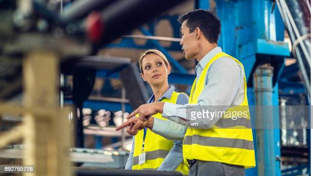 Male and female engineer discussing something