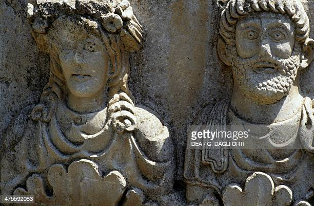 Male and female faces detail of a stele of Saturn Roman city of Timgad Algeria Roman civilisation