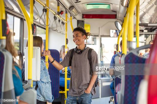 male and female friends traveling together in bus - izusek stock pictures, royalty-free photos & images