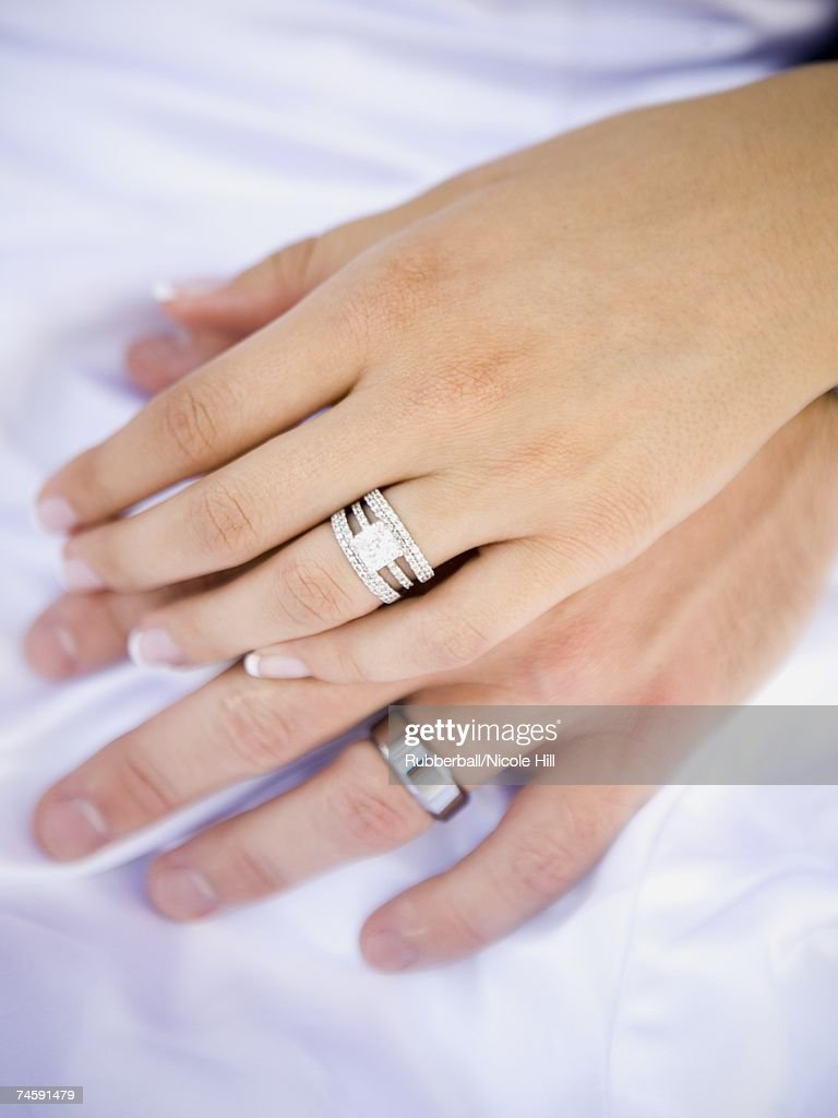 Male And Female Hands With Wedding Rings Stock Photo Getty Images