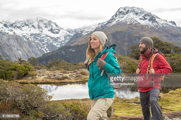 Male and female hiker on mountain trail