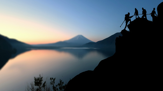 Male and female hikers climbing up silhouette mountain cliff and one of them giving helping hand.helps and, team work concept. - gettyimageskorea