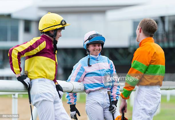 Male and Female Jockeys at Racecourse