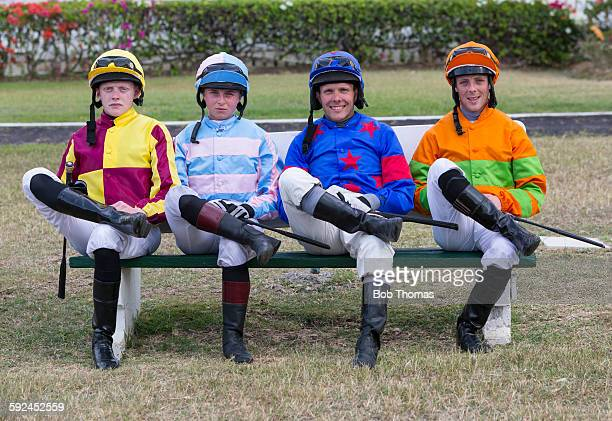 Male and Female Jockeys Relaxing at a Racecourse
