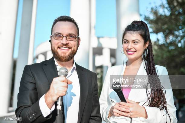 male and female journalists going live from city center elections - presidential candidate stock pictures, royalty-free photos & images