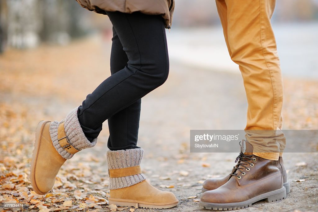 Male and female legs during a date : Stock Photo