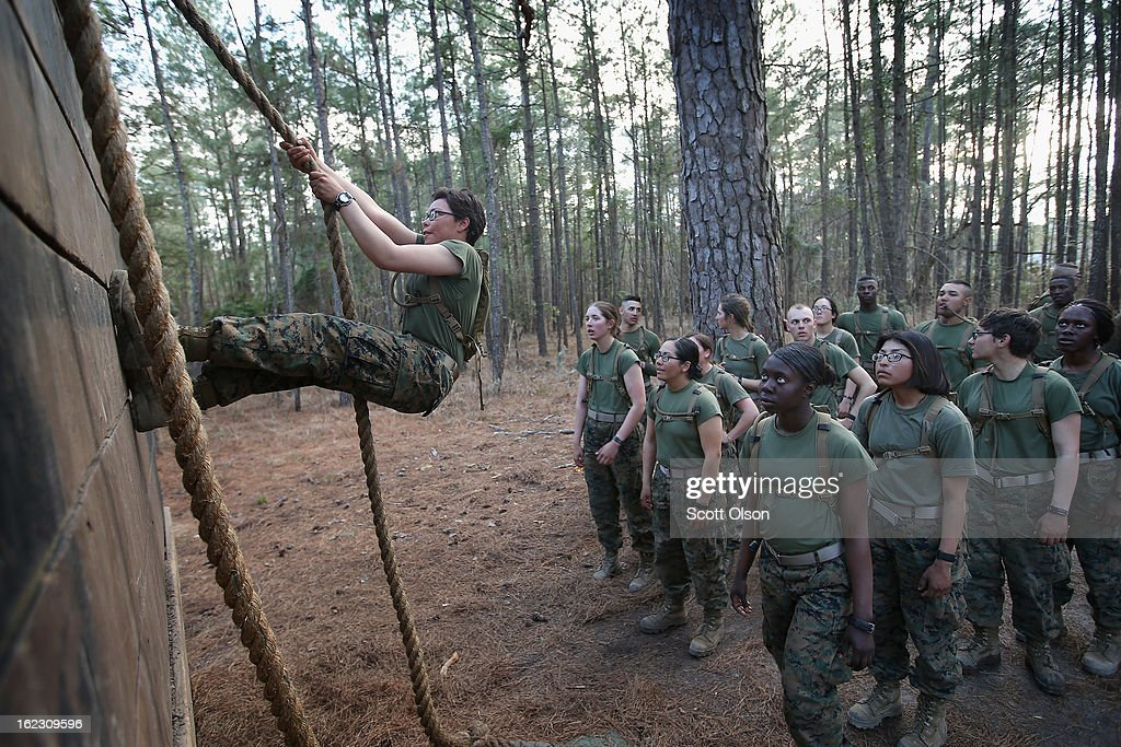 Male and female Marines wait to climb an obstacle on the Endurance Course during Marine Combat Training (MCT) on February 20, 2013 at Camp Lejeune, North Carolina. Since 1988 all non-infantry enlisted male Marines have been required to complete 29 days of basic combat skills training at MCT after graduating from boot camp. MCT has been required for all enlisted female Marines since 1997. About six percent of enlisted Marines are female.