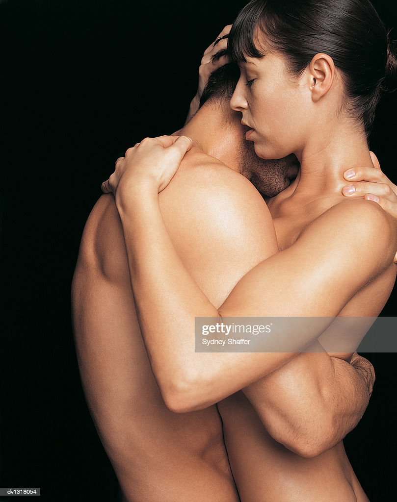 male and female nude in an embrace stock photo | getty images