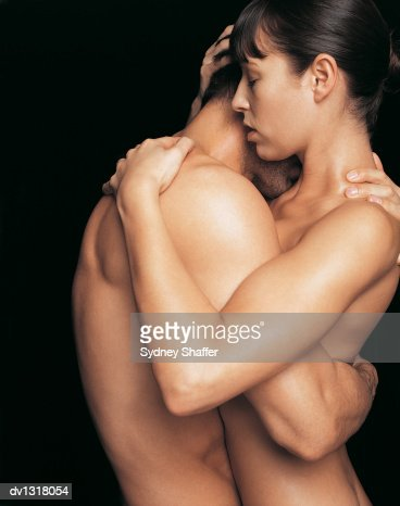 female and male nude embrace