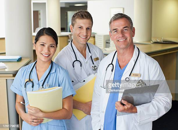 Male and female nurse with doctor
