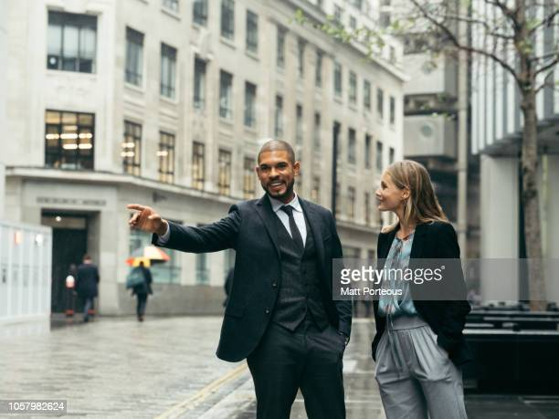 Male and female office workers on the street
