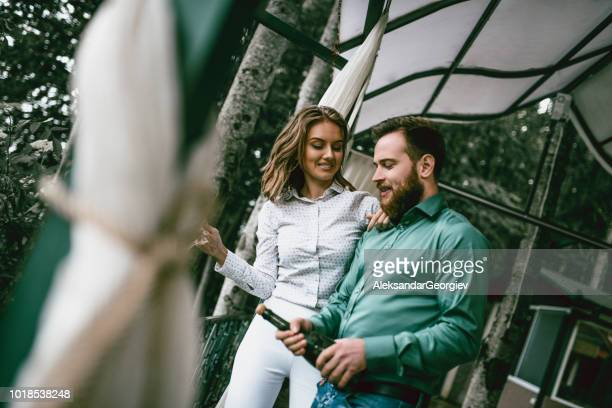 male and female opening champagne bottle during celebration - drunk wife at party stock pictures, royalty-free photos & images