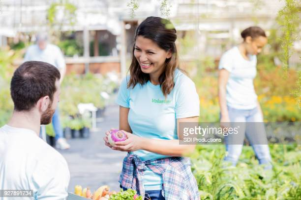 male and female plant nursery volunteers working together - rutabaga stock pictures, royalty-free photos & images