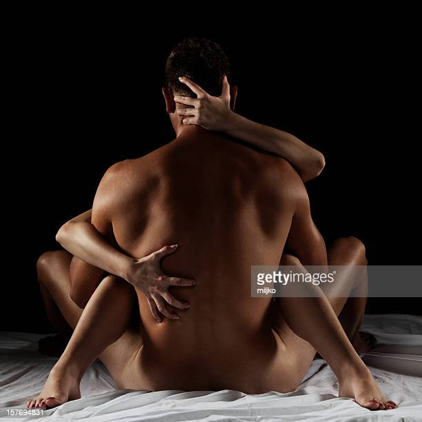 Male and female posing in a sexual position