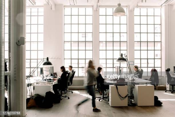 male and female professional coworkers working in office - employment issues stock pictures, royalty-free photos & images