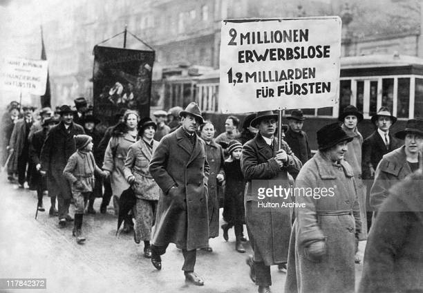 Male and female protestors carrying a banner which reads '2 millionen erwerbslose2 milliarden fur fursten' during a demonstration by unemployed...
