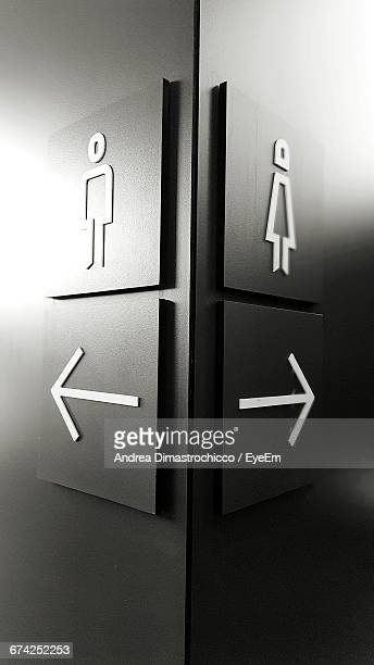 Male And Female Restroom Symbols Indicated By Arrow Sign