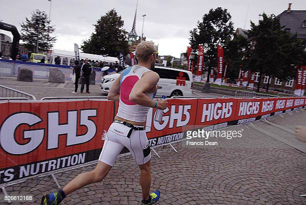 COPENHAGEN /DENMARK Male and female running in Ironman sport event ironman evet photos are taken at infrom danish parliament house christiansborg and...