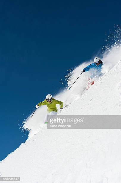 Male and female skiers racing downhill, Obergurgl, Austria