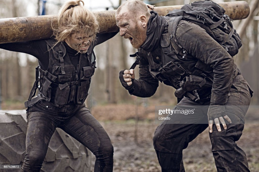 Male and Female Soldiers in Military Shoot in woodlands : Stock Photo