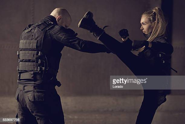 Male and female swat team members fighting in urban setting