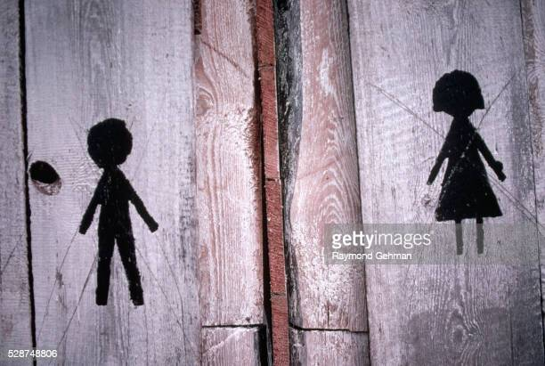 male and female symbols on outhouse - bialowieza forest stock pictures, royalty-free photos & images