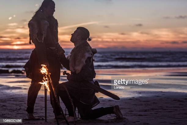 male and female viking warrior couple in wild highland countryside - historical romance stock photos and pictures