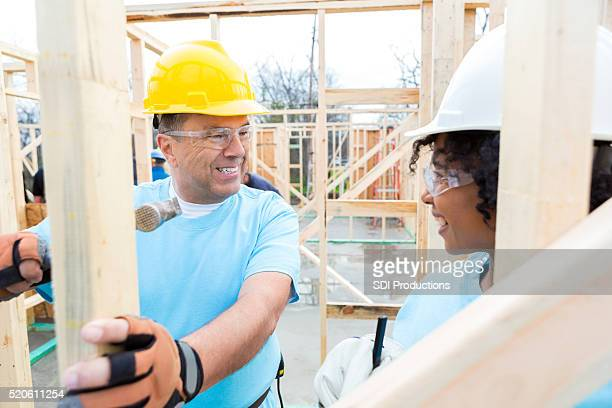 Male and female volunteers build home for charity