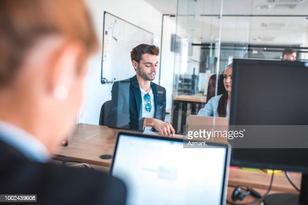 Male and female web designers working in office