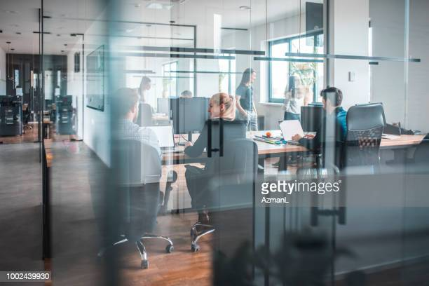 male and female web designers working in office - office cubicle stock pictures, royalty-free photos & images