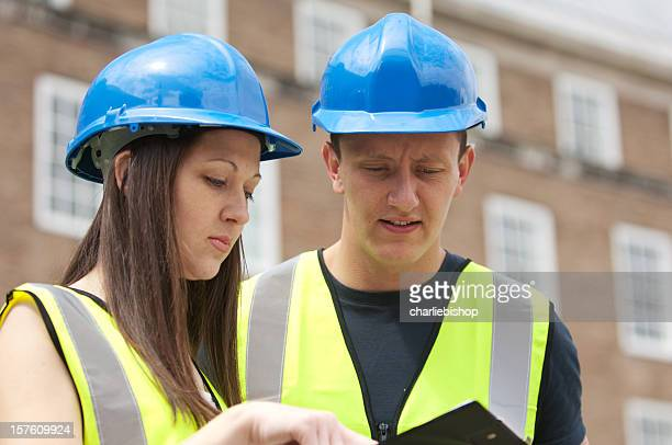 Male and female young construction engineers