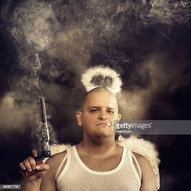 male angel with smoking colt - male angel stock photos and pictures